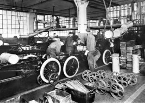 The moving assembly line became operational at the Highland Park Plant in 1913. Thanks to this and many other innovations, the time it took to build a Model T dropped from up to 14 hours to about 1.5 hours. From the collections of The Henry Ford and Ford Motor Company. (4/22/08)